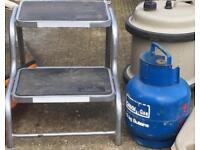 Caravan step and gas bottle
