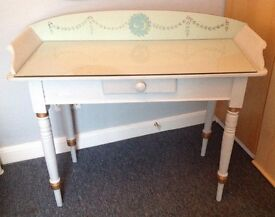 Dainty bedside table with glass top