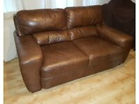 3 piece leather suite: Sofa and 2 armchairs; leather care kit.