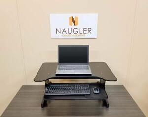 Sit/Stand Desk Risers make any desk height adjustable!