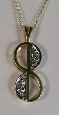 - [1834] 14kt Solid Yellow Gold 4 Diamond Pendant in a figure