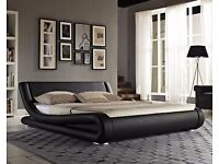 Striking black faux leather curved sleigh bed, 4ft6 double, with gold ortho mattress, free delivery