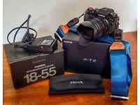Fujifilm X-T2 with XF18-55mm Lens plus extra battery, Peak Design Strap and Hoya polarising filter
