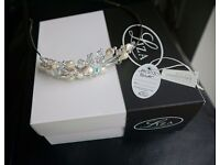 Bridal Headband from the Liza collection. Never worn. Silver band with swarovski in the design.
