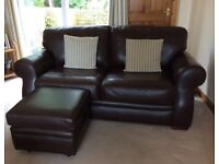 2 dark brown leather sofas plus a matching footstool. Made in Scotland by Reid.£
