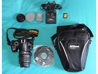 Nikon D3000 DSLR with 18-55mm Nikkor lens and accessories