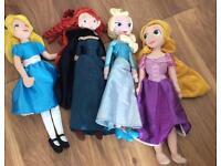 Four Disney soft dolls