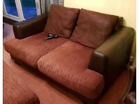 Excellent condition 2 seater brown sofa with matching footstool
