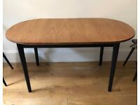 Black Wood & Wood Veneer Oval Dining Table