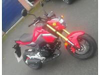 Honda msx125 (grom) 7 miles on clock