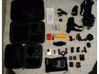 GoPro Hero3+ And various accessories. 2 official batteries, 2 carry cases for camera and equipment.