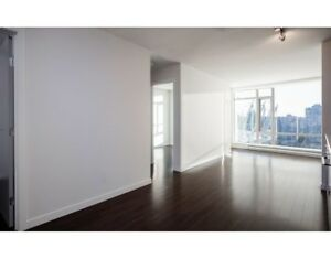 Bright, Over-height Ceiling 1Br plus Den