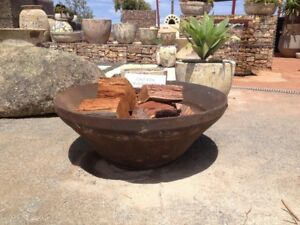 Crushing cone fire pit