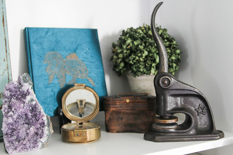 As seen in my collected home: Vintage Embossing Seal, Brass Surveyors Compass, Old Binoculars and an amethyst geode.