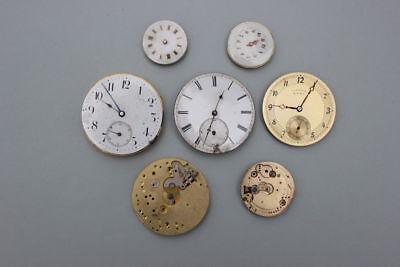 7 Taschenuhrenwerke, um 1900  ein Werk mit Schwanenhals-Feinregulierung
