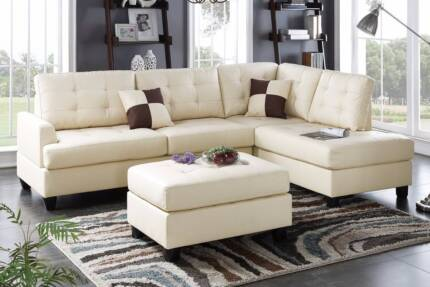 ***BRAND NEW***CHAISE SOFA AND FREE OTTOMAN LEATHER-LOOK