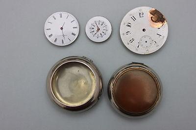 3 Taschenuhrwerke um 1900 + 2 Uhrenübergehäuse