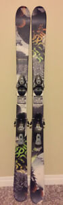 Salomon Treat twin tip skis.