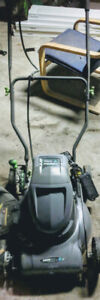 12 Amp hour Earth Wise Lawn Mower with 24 volt battery pack.