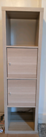 IKEA Kallax shelving unit with door inserts