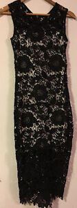 Laced black 3/4 length dress with white/cream underlay