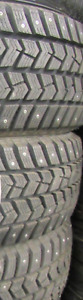 NEW TREAD ON 4 TIRES P225/70/16 WINTER STUDDED