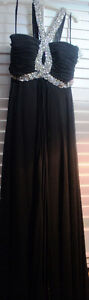 Chicas size small black gown $595 selling for $100