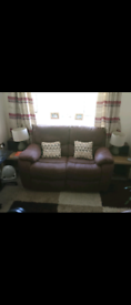 Two seater reclining brown sofa