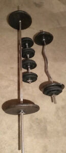 """300 Lbs Of 1"""" Cast Iron Weight Plates With DB Handles & Barbells"""