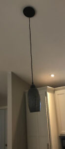 A set of hand blown glass pendant lights for sale.