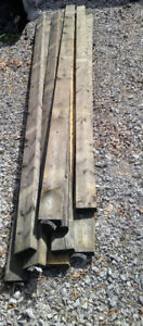 9 pieces of new 2 x 4 x 8-ft Grey Pressure Treated Lumber