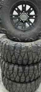 4 TIRES - 37X13.50R17 - 75% Nitto Mud Grappler WITH RIMS (8X6.5)