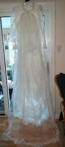 Immaculate wedding dress with long train and matching veil