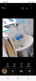 Beige bath, toilet, cistern, basin, pedestal and taps