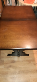 Extending dark oak dining table and 4 chairs