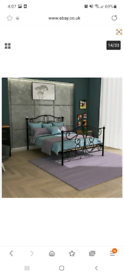 Black Double metal bed in excellent condition with mattress