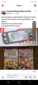 Nintendo switch light +2 games.