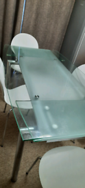 Glass extending dining table for sale not free
