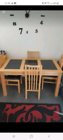 Table and 4 chairs.