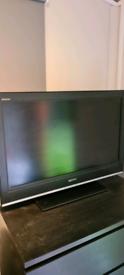 Sony kdl-32s3000 TV with headphones