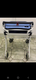 Indoor walking frame with removable tray.