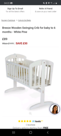 Wooden Swinging Crib excellent condition