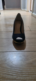 Navy blue shoes with gold heel
