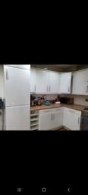 Full white kitchen with appliances