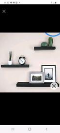 Trio of black block floating shelves