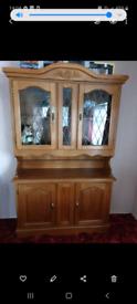 A glass door cabinet dresser
