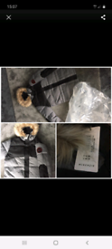 Brand new men's desighner Mckenzie thick winter coat size Large.