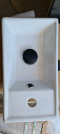 New sink with black slotted waste