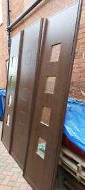 Sliding wardrobe doors in dark brown wood effect in good condition
