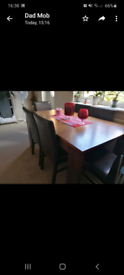 Extending dining table + 6 chairs